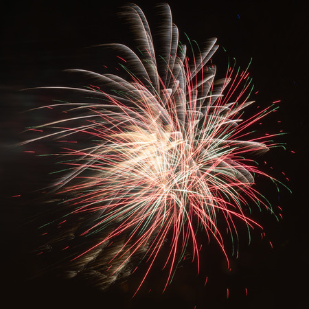 Colorful red fireworks in the night sky 版權商用圖片