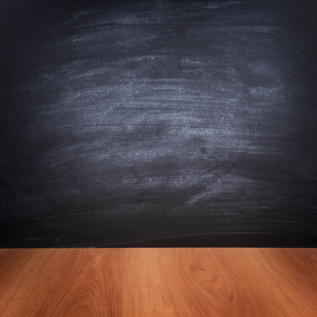 Background of the school board and wooden table