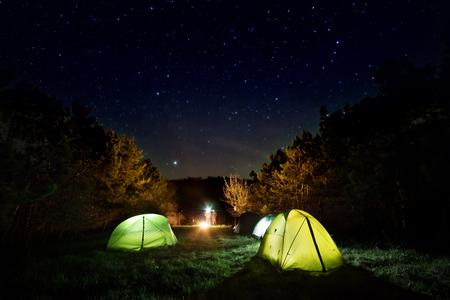 Multicolored tents under the starry sky 版權商用圖片
