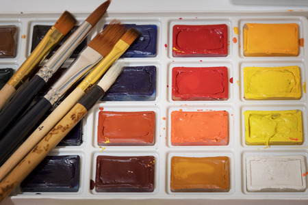 Watercolors in a box with brushes
