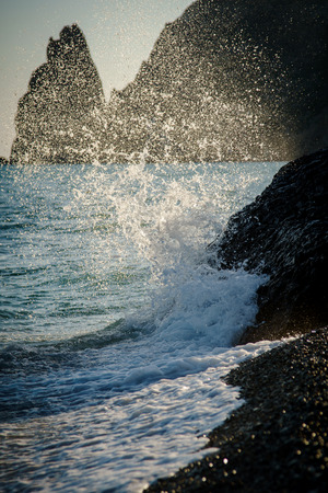 The sea wave is broken about the coastal stone