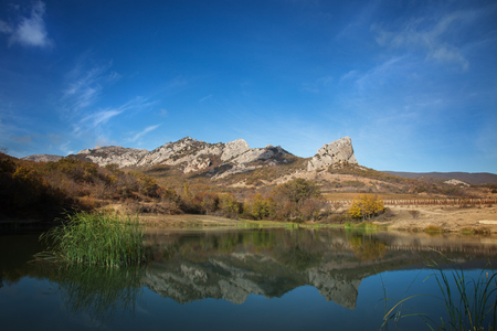 Landscape. The lake at the foot of the mountains against the blue sky 版權商用圖片