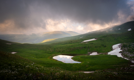 Lake Psenodah in the middle of alpine meadows in the mountains. Lago-Naki. Russia