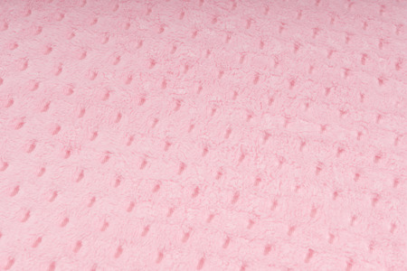 Background of pink knitted fabric