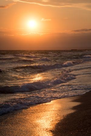 Landscape. The Waves on the seashore at sunset 版權商用圖片