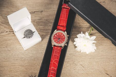 ring with watch on gift boxes on desk