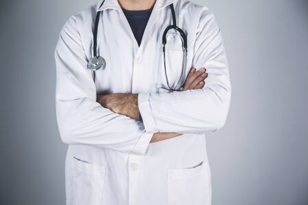 doctor hand stethoscope on the gray wall background