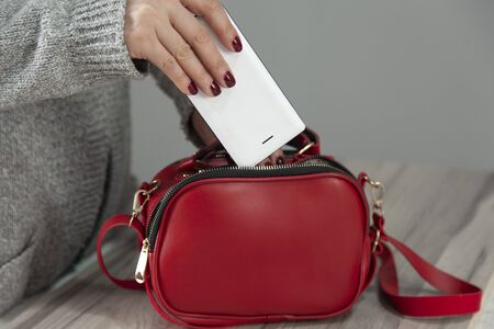 woman hand phone with bag pocket 스톡 콘텐츠