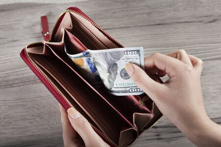 woman hand money with wallet on desk