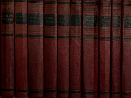 old aged red books on the shelf backgrounds Imagens