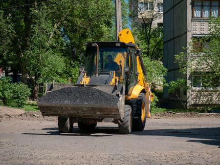 Buldozer Making and constructing a new asphalt road near the civ Editoriali