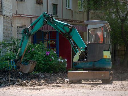 Excavator Making and constructing a new asphalt road near the ci Redakční