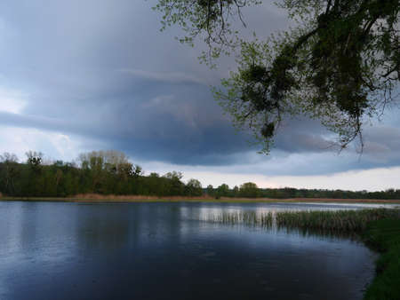 Stormy sky over the river. Local tourism