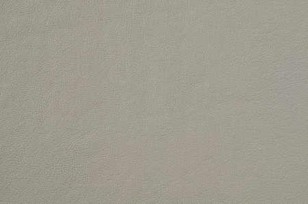 Graues weiches Leder für den Hintergrund. Naturleder Textur Platz für Text auf dem grauen Hintergrund der Haut hautnah. Kunstleder aus Polyester. Standard-Bild