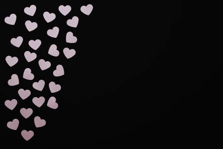 Floating pink hearts. Small scattered hearts on a black background with space