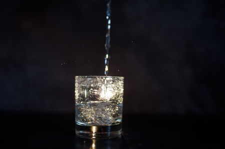 vials: the glass, vials of air, stream of water, water flows