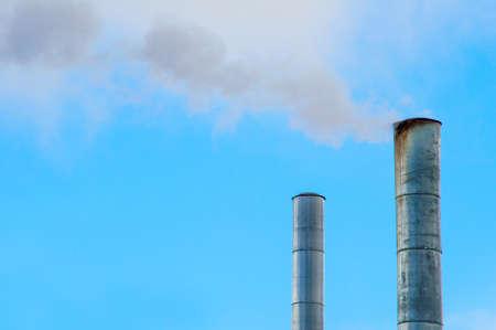 Smokestacks against a blue sky