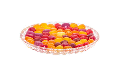 Colored lollipops in a crystal plate on a white background. The image is located at the bottom of the field. There is a place for insertion