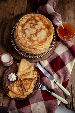 Pancake foods. A stack of thin pancakes on a plate. Russian pancake week.Shrove tide. Thin pancake with crispy crust. Homemade pastries. Pancakes for breakfast. Appetizing food.