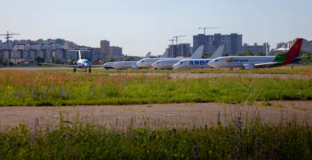 Kyiv, Ukraine - June 26, 2020: A lot of aircraft in the parking lot of the airport. The plane is on the platform of the Kyiv airport. Flights by air. Runway. Cockpit Planes.