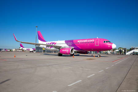 Kyiv, Ukraine - June 26, 2020: Aircraft AIRBUS A320-200 WIZZ AIR airlines. The plane is on the platform of the Kyiv airport. Flights by air. Runway. Close-up, copy space. Passenger airplane.