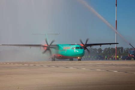 Kyiv, Ukraine - June 27, 2020: Aircraft ATR 72-212A airline WindRose. Airplane medium-range turboprop passenger aircraft. Boryspil International Airport. Ukrainian plane. Runway. Propeller.