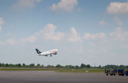 Kyiv, Ukraine - June 23, 2020: Cargo ULS aircraft. The plane lands at the international airport Boryspil. Terminal Runway D. Fly in the sky clouds. Copy space.