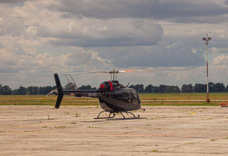 Ukraine, Kyiv - July 8, 2020: The black helicopter is at the airport on the runway. Private transport air damage in the parking lot. Aircraft: Bell 505 UR-HOT 新聞圖片