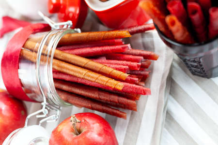 Pastille, fruit rolls. Fruit Marshmallow. Pureed fruits are dried and rolled up. Natural and healthy snack food. Sugar-Free, healthy nutrition, sweetness. Фото со стока