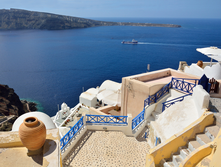 The traditional architecture of Santorini, Oia, sea view  photo
