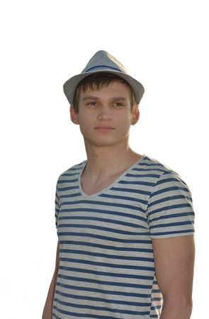 delineate: A young man in the hat and striped t-shirt on a white background, isolated
