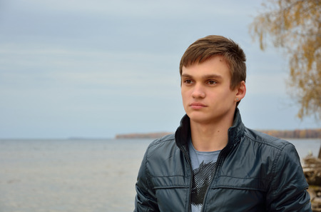lamentable: A young man in front of the sea