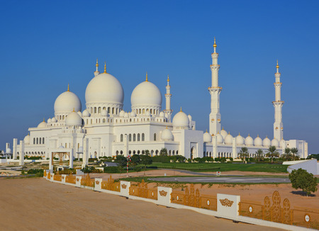 Sheikh Zayed Mosque in Abu Dhabi at sunset, UAE  Sunset reflected in the marble floor of the mosque  photo