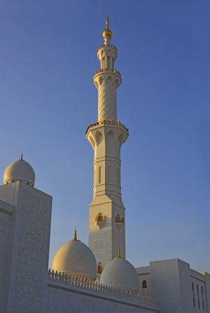 Mosque tower of the Sheikh Zayed Mosque in Abu Dhabi at sunset, UAE  photo