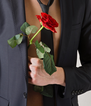 man s: Man s hand with a rose