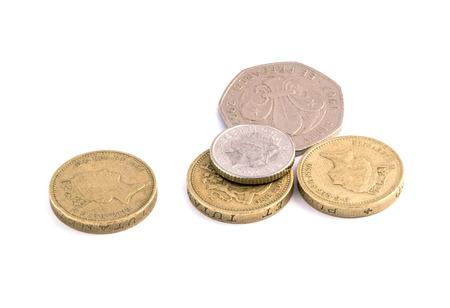 pound: Coins, British pounds on a white background  Stock Photo