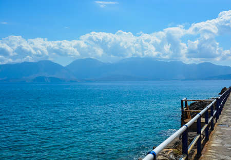 sun drenched: View from the pier to the Aegean Sea and the mountains  Greece