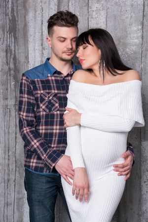 expectant arms: Beautiful couple in love. Man and woman are going to become parents. Pregnancy. Stock Photo