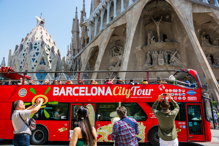 Editorial. May 2018. Tourist bus in front of the Sagrada Familia facade in Barcelona, Spain Editorial
