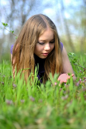 beauty young girl lies on grass