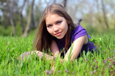 young girl is laying on green grass Stock Photo - 13204595