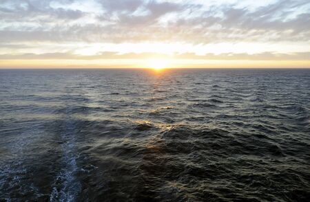 Sparkling sunset above sea