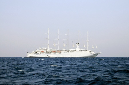 Very big cruise Yacht at anchor at sea in the island of mykonos Editorial