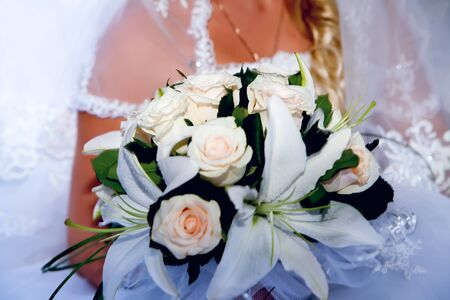 Bride holding bridal bouquet close up Stock Photo