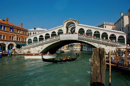 Venice Grand canal with gondolas and Rialto Bridge, Italy Editorial