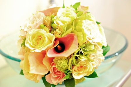 A nice wedding bouquet of roses and lilies