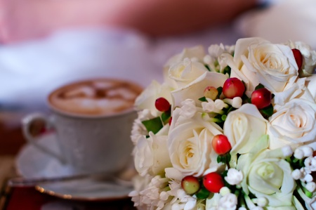 love cup , heart drawing on latte art coffee and wedding bouquet