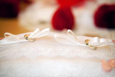 gold wedding rings on the pincushion  Stock Photo
