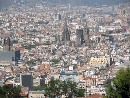 Aerial view of Barcelona city with Sagrada Familia in background, Spain