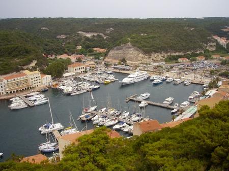 Sailboat in front of Bonifacio beacon , Corsica, France